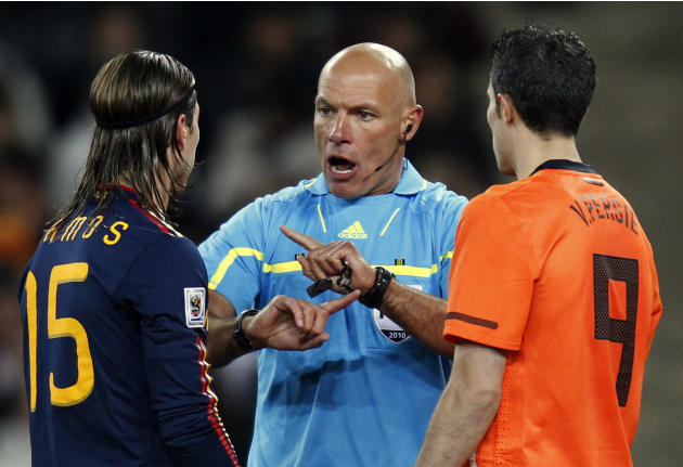 In this Sunday, July 11, 2010 file photo, referee Howard Webb of England, center, speaks with Spain's Sergio Ramos, left, and Netherlands' Robin van Persie during the World Cup final soccer ma