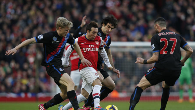 Arsenal's Santi Cazorla, second left, competes with Crystal Palace's Jonathan Parr, left, Mile Jedinak, third left, and Damien Delaney during their English Premier League soccer match at Emirates Stadium in London, Sunday, Feb. 2, 2014