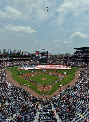Jets fly over ceremonies before a baseball game between the Atlanta Braves and Boston Red Sox, on Memorial Day, Monday, May 26, 2014 in Atlanta, Ga