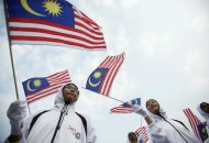 Malaysian youths wave national flags during the National Day celebrations marking the 56th anniversary of the country's independence in Kuala Lumpur August 31, 2013. — Reuters pic