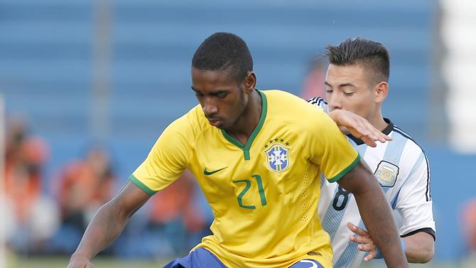 Brazil's Gerson defends the ball under pressure from Argentina's Leonardo Gabriel Rolon during their match for the final round off the South American Under-20 Championship in Montevideo