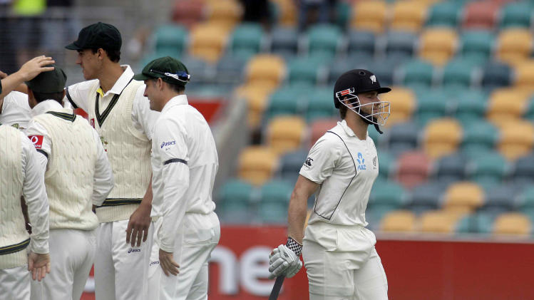 New Zealand batsman Kane Williamson makes his way back to the pavilion after being caught by Ricky Ponting off the bowling of Peter Siddle during the third day of play in the second test match in Hobart, Australia, Sunday Dec. 11, 2011. (AP Photo/Chris Crerar)