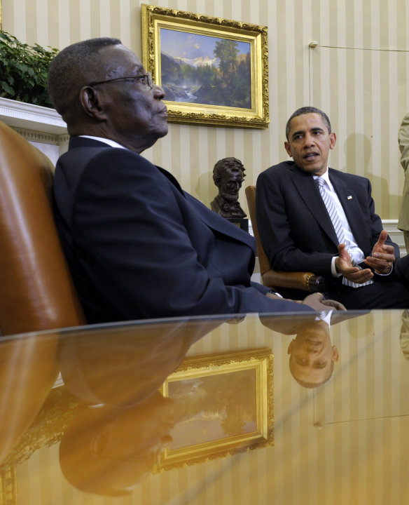 File - in this file photo taken on Thursday, March, 8, 2012, President Barack Obama, right, speaks as President John Evans Atta Mills of Ghana, left, listens during their meeting in the Oval Office of