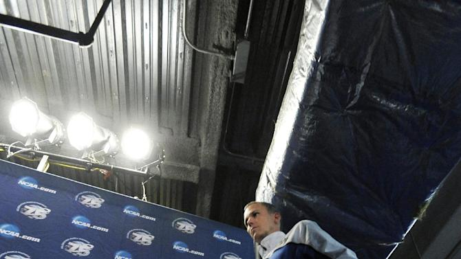 Florida Gulf Coast head coach Andy Enfield walks to a news conference for a third-round game of the NCAA college basketball tournament, Saturday, March 23, 2013, in Philadelphia. Florida Gulf Coast is scheduled to play San Diego State on Sunday. (AP Photo/Michael Perez)
