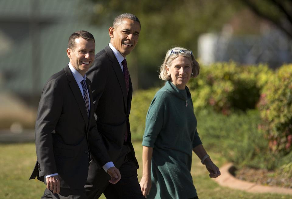 President Barack Obama, accompanied by debate prep adviser Anita Dunn, right, and senior White House adviser David Plouffe, leave the Kingsmill Resort, Tuesday, Oct. 16, 2012, in Williamsburg, Va., for New York and the presidential debate. (AP Photo/Carolyn Kaster)