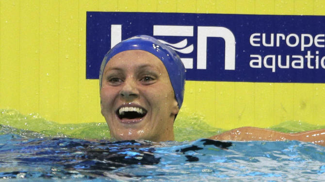 Britain's Jazmin Carlin celebrates winning the women's 800m freestyle final at the LEN Swimming European Championships in Berlin, Germany, Thursday, Aug. 21, 2014. (AP Photo/Gero Breloer)