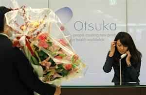 A flower arrangement to celebrate Otsuka Holdings Co's listing on the Tokyo Stock Exchange is delivered at the company headquarters in Tokyo