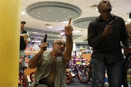 Security officers secure an area inside Westgate Shopping Centre in Nairobi September 21, 2013. REUTERS/Siegfried Modola
