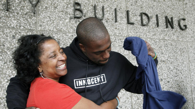 Brian Banks reacts with his mother, Leomia Myers, outside court after his rape conviction was dismissed Thursday May 24, 2012 in Long Beach, Calif. Banks, a former Long Beach high school football star and prized college recruit who served more than five years in prison for a rape he did not commit had his conviction overturned Thursday with his accuser recanting her story( AP Photo/Nick Ut)
