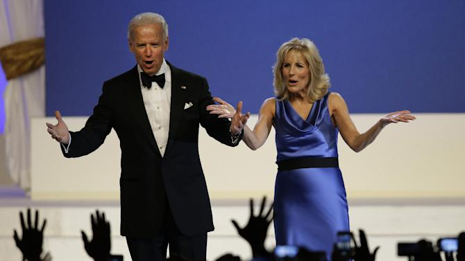 Vice President Joe Biden and Jill Biden react to the crowd at The Inaugural Ball in the Washington convention center during the 57th Presidential Inauguration in Washington, Monday, Jan. 21, 2013. (AP Photo/Paul Sancya)