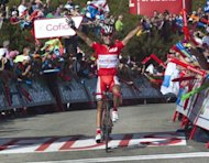 Spanish cyclist Joaquim Rodriguez of Katusha team celebrates as he crosses the finish line to win the fourteenth stage of the Vuelta Tour of Spain, a 149,2 kms ride from Palas de Rei to Puerto de Ancares