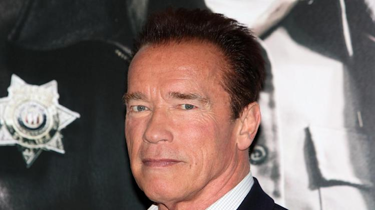 "Arnold Schwarzenegger seen at a photo call for  the film "" The Last Stand"" in London Tuesday Jan. 22. 2013 . (Photo/Jon Furniss Photography/Invision/AP)"