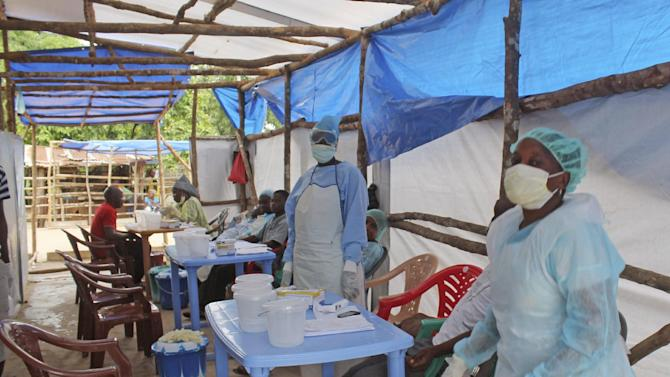 FILE - This is a Sunday, July 27, 2014   file photo of medical personnel inside a clinic taking care of Ebola patients in the Kenema District on the outskirts of Kenema, Sierra Leone. On July 23 the doctor in charge of battling Sierra Leone's current Ebola outbreak became ill with the deadly disease, the country's health minister confirmed. He later died. (AP Photo/ Youssouf Bah, File)