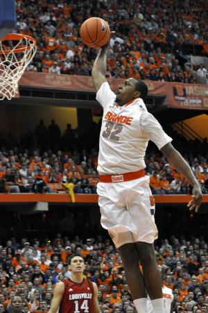Syracuse's Kris Joseph dunks against Louisville during the second half of an NCAA college basketball game in Syracuse, N.Y., Saturday, March 3, 2012. Syracuse won 58-49. (AP Photo/KevinRivoli)