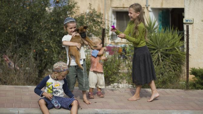 In this Aug. 31, 2011 photo, Jewish children play outside the home of Rabbi Arele Harel in the West Bank Jewish settlement of Shiloh, near Nablus. Harel is an Israeli rabbi setting up gay men with lesbian women in a bid to give religious homosexuals a chance to have children while remaining observant, as homosexuality is viewed as a sin and a violation of Halacha, or traditional Jewish law. (AP Photo/Ariel Schalit)