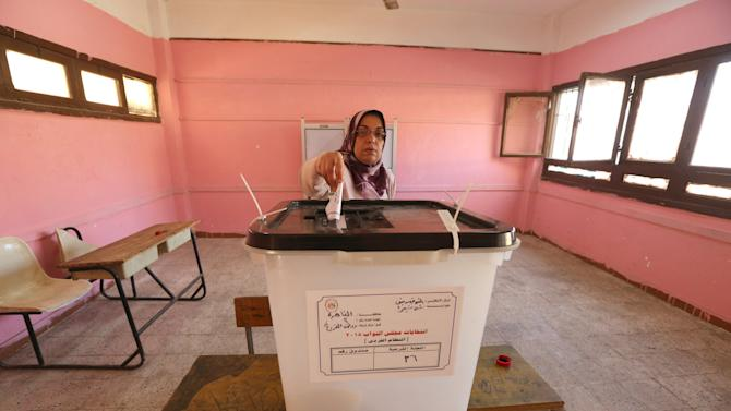 A woman casts her vote at a school used as a polling station during the second phase of the parliamentary election runoff at the Shubra area of Cairo