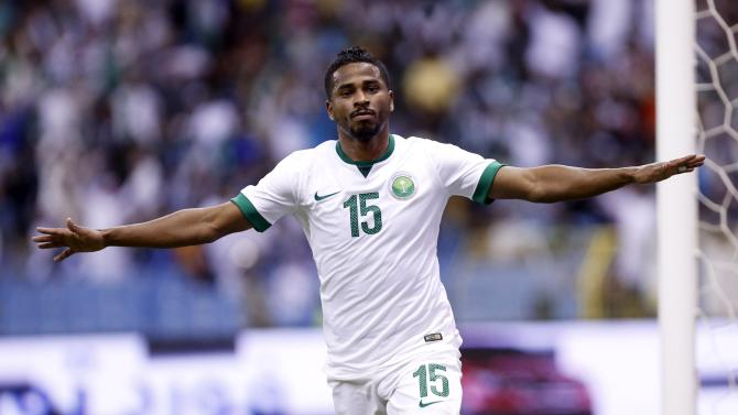 Saudi Arabia's Nasser Al-Shamrani celebrates after scoring a goal against UAE during their Gulf Cup semi-final soccer match in Riyadh