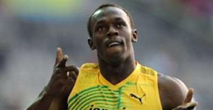 Usain Bolt celebrates winning