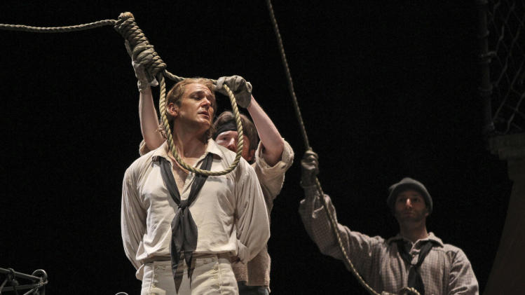 "In this Wednesday, May 2, 2012 photo, Nathan Gunn performs the title roll during the final dress rehearsal of Benjamin Britten's ""Billy Budd"" at the Metropolitan Opera in New York.  (AP Photo/Mary Altaffer)"