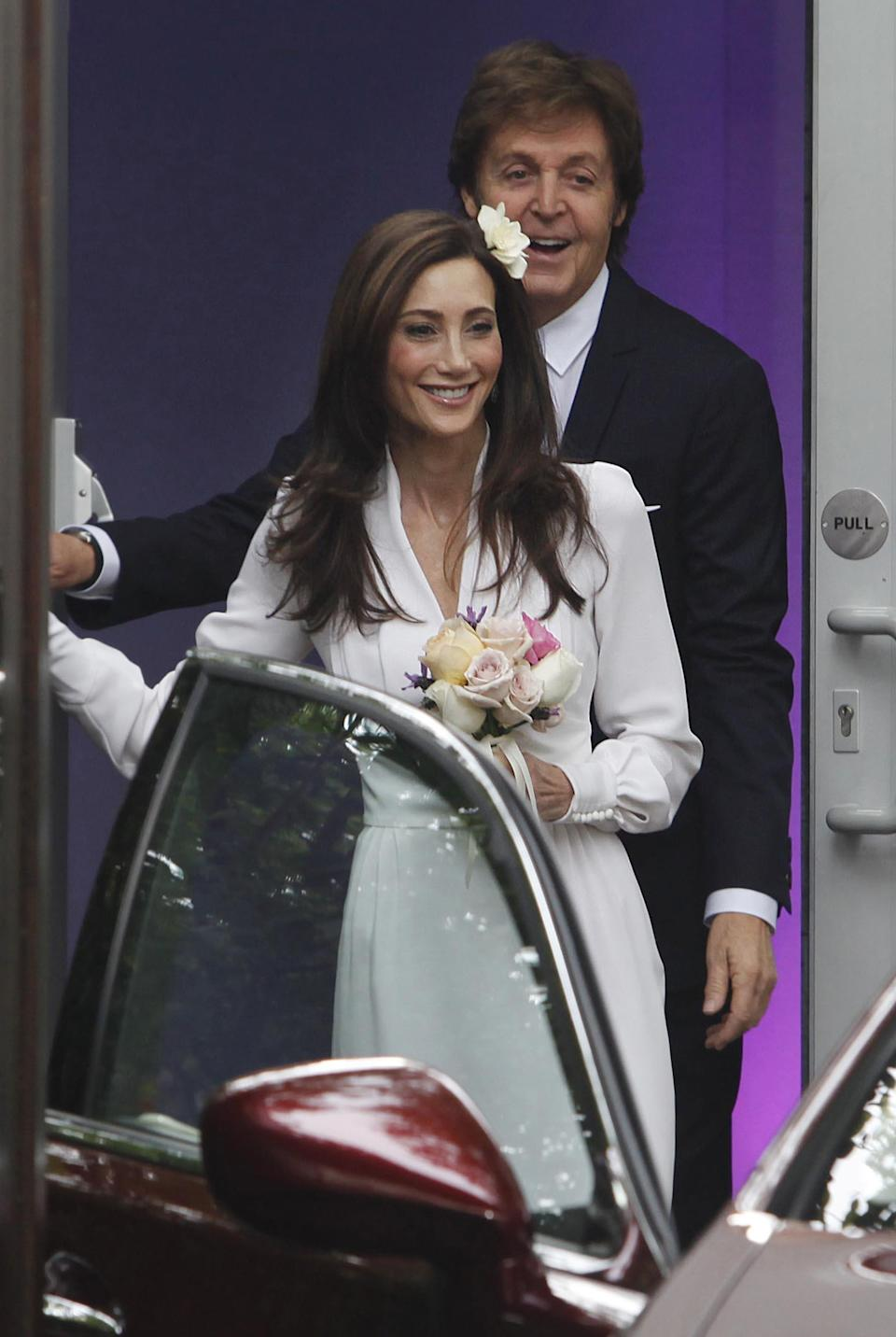 Nancy Shevell with Sir Paul McCartney leaving his house in north London to get married at Marylebone Town Hall,  in the St. John's Wood neighborhood of London Sunday Oct. 9, 2011. (AP Photo / David Parry, PA) UNITED KINGDOM OUT - NO SALES - NO ARCHIVES