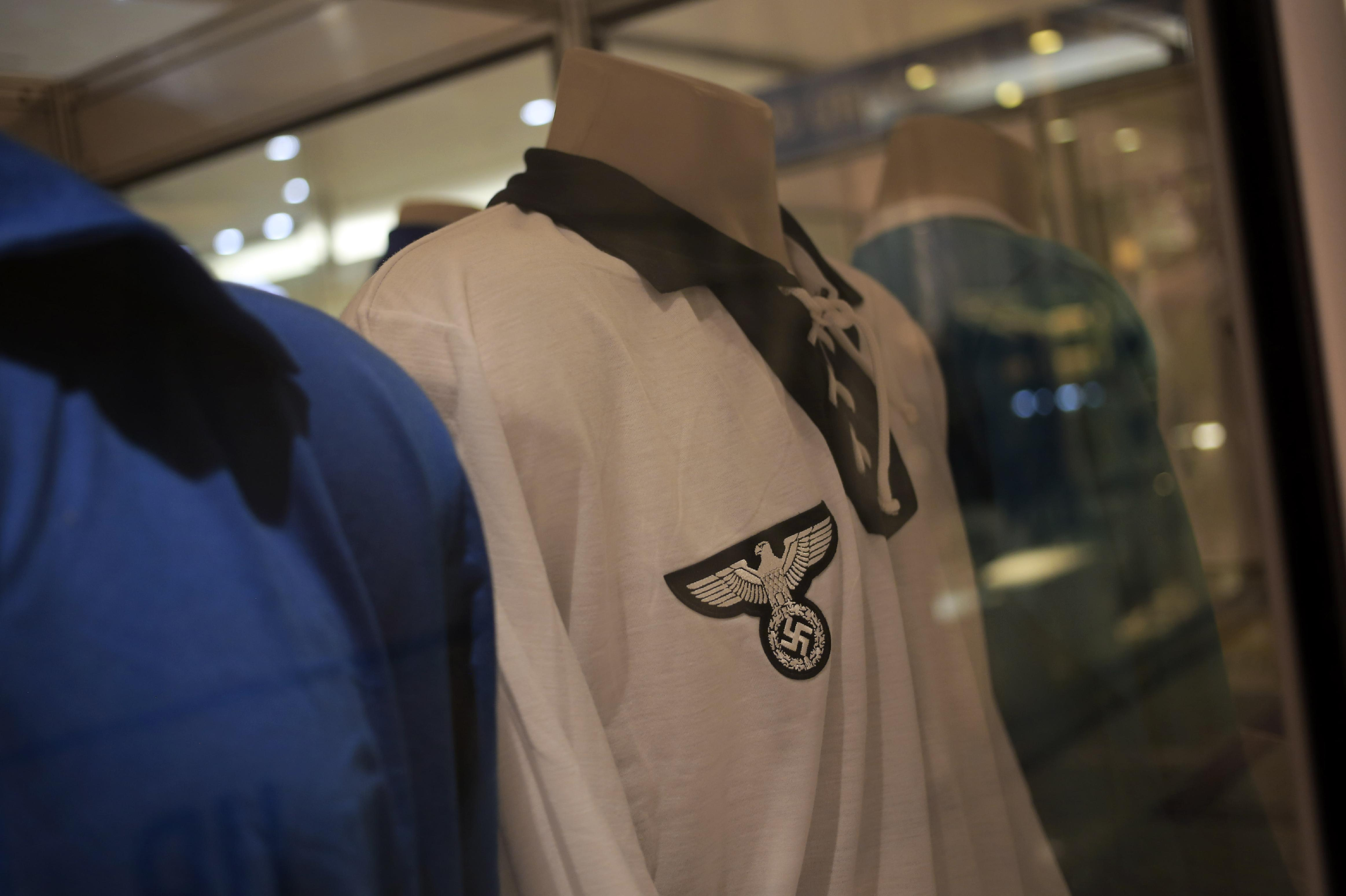 A Germany 1934 FIFA Soccer World Cup team jersey is displayed among other national soccer team jerseys on a shopping mall in Salvador, Brazil, Thursday, June 19, 2014. The nazi eagle and swastica clearly visible on the jersey's breast. (AP Photo/Bernat Armangue)