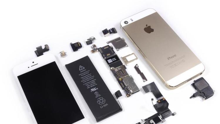 Handout image released by iFixit.com shows a disassembled Apple iPhone 5S handset during a product teardown in Melbourne