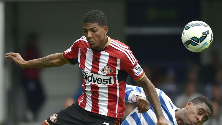 Queens Park Rangers' Fer challenges Sunderland's Van Aanholt during their English Premier League soccer match at Loftus Road in London