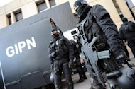 French commandoes stand guard outside the National Police College in Saint-Cyr-au-Mont-d'Or, on October 15, 2012