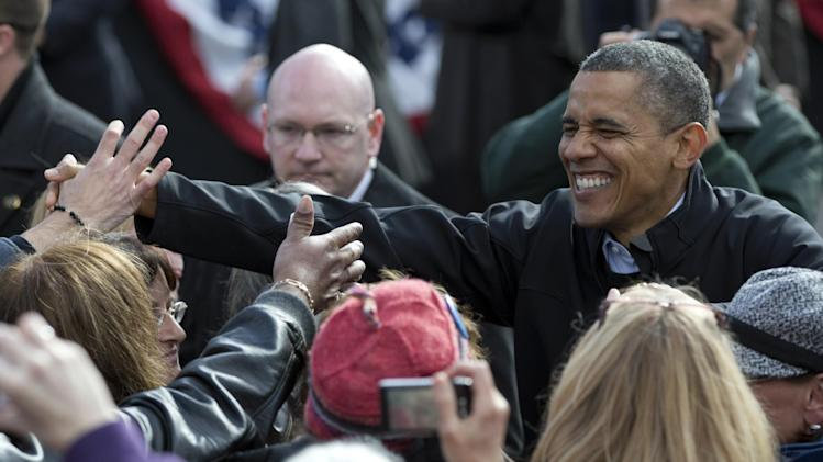 President Barack Obama shakes hands at a campaign event in the State Capitol Square, Sunday, Nov. 4, 2012, in Concord, N.H. (AP Photo/Carolyn Kaster)