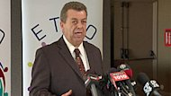 ETFO president Sam Hammond is seen speaking with members of the media Wednesday, the same day the union announced plans for a day-long political protest on Friday.