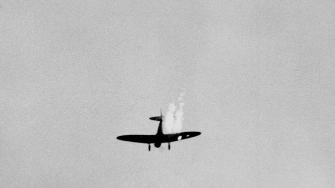 FILE - In this Dec. 7, 1941 file photo, a Japanese plane goes into its last dive as it heads toward the ground in flames after it was hit by Naval anti-aircraft fire during a surprise attack on Pearl Harbor, Hawaii. (AP Photo)