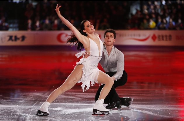 Virtue and Moir perform at the ISU World Figure Skating Championships gala presentation in London