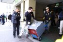 Federal agents remove a safe after conducting a raid on Oaksterdam University in Oakland