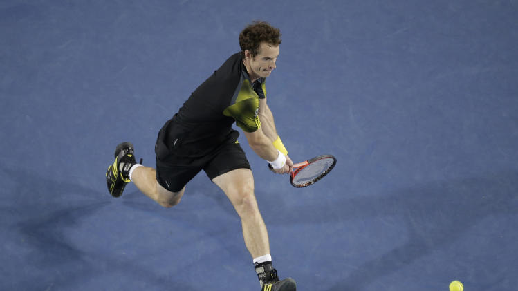 Britain's Andy Murray hits a backhand return to Switzerland's Roger Federer during their men's semifinal  at the Australian Open tennis championship in Melbourne, Australia, Friday, Jan. 25, 2013. (AP Photo/Rob Griffith)