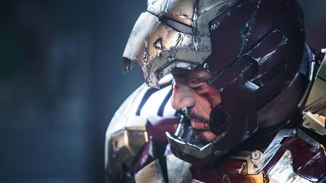 """This undated publicity photo released by Marvel shows Robert Downey Jr. as Tony Stark/Iron Man in a scene from Marvel's """"Iron Man 3."""" The movie releases in the USA on May 3, 2013.(AP Photo/Marvel, Zade Rosenthal)"""