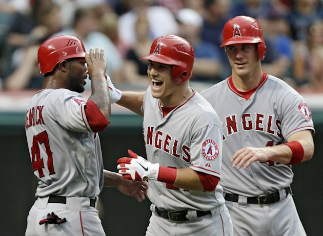 FILE - This July 3, 2012 file photo shows Los Angeles Angels' Mike Trout, center, celebrating with Howard Kendrick (47) and John Hester after Trout's three-run home run off Cleveland Indians starting