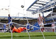 Chelsea's defender Ashley Cole (L) scores against Stoke City at Stamford Bridge in London. Cole's late goal saw Chelsea to a 1-0 win over Stoke City as the European champions went four points clear at the top of the Premier League