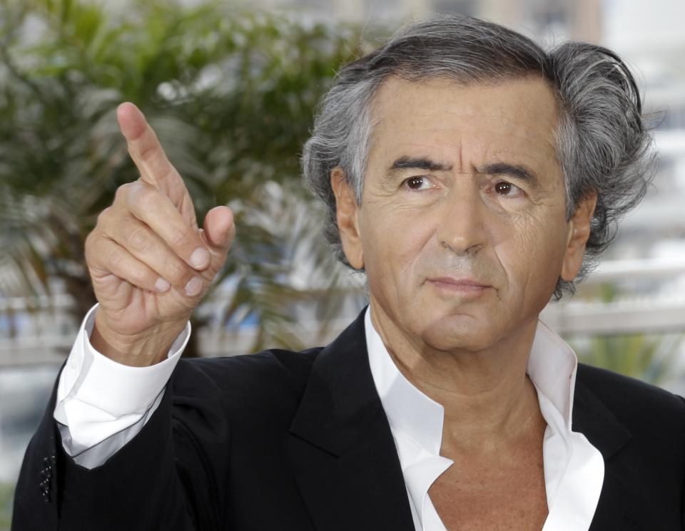 Director Bernard-Henry Levy poses during a photo call for The Oath of Tobruk at the 65th international film festival, in Cannes, southern France, Friday, May 25, 2012. (AP Photo/Lionel Cironneau)