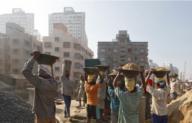 Labourers work at the construction site of a residential complex in Kolkata