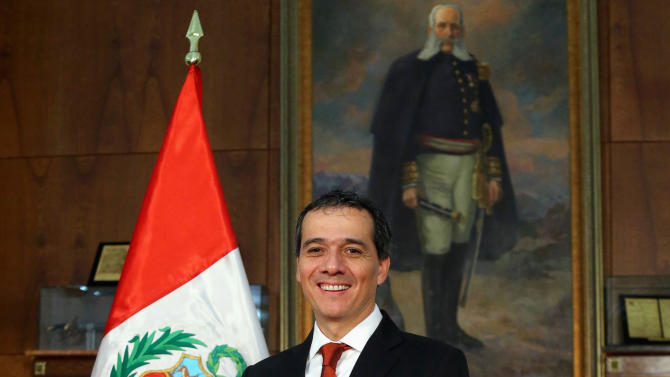 New Finance Minister Alonso Segura poses for a picture after the swearing-in ceremony at the government palace in Lima