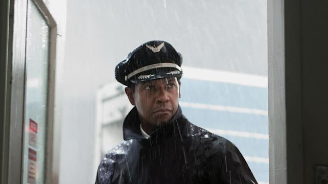 """FILE - This publicity film image released by Paramount Pictures shows Denzel Washington portraying Whip Whitaker in a scene from """"Flight."""" Washington plays an airline pilot who, despite being hung-over, drunk and coked-up, manages to bring down a rapidly deteriorating plane in a daring emergency landing on what should have been a routine flight between Orlando, Fla., and Atlanta.  Alcohol plays a prominent role in """"Flight,"""" but Anheuser-Busch says it wasn't consulted beforehand and is asking the filmmakers and Paramount Pictures to remove the Budweiser logo and any other trademarks from the film.(AP Photo/Paramount Pictures, Robert Zuckerman)"""