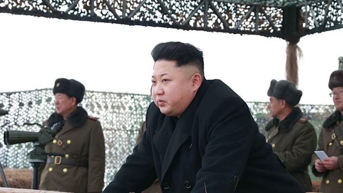 North Korean leader Kim Jong Un gives a field guide during a winter river-crossing attack drill of the armored infantry sub-units of the motorized strike group in the western sector of the front of the KPA