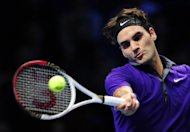Switzerland's Roger Federer returns a shot during his match against Serbia's Novak Djokovic on the eighth day of the ATP World Tour Finals in London. Federer insists his dramatic defeat against Djokovic was exactly the kind of epic showdown that stops him thinking about retiring