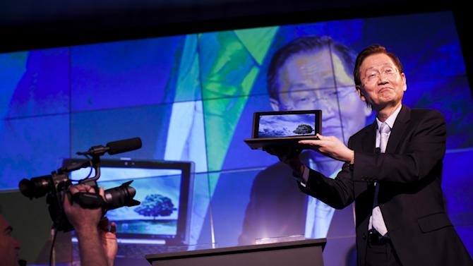 Asus Chairman Jonney Shih shows the new Asus Padfone during a press conference at the Mobile World Congress, the world's largest mobile phone trade show, in Barcelona, Spain, Monday, Feb. 27, 2012. (AP Photo/Emilio Morenatti)