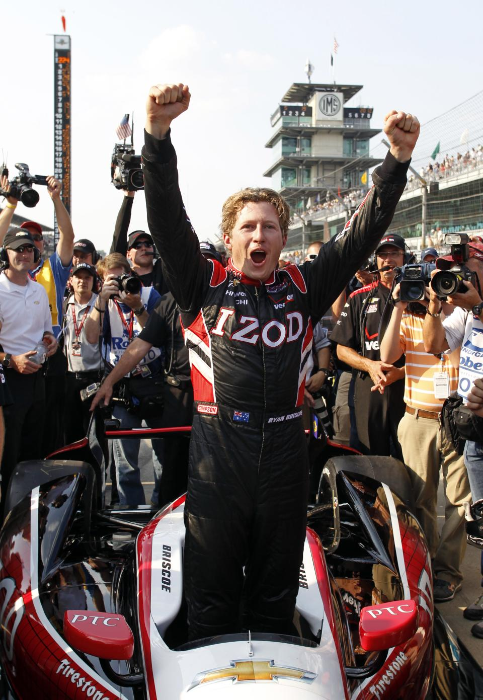 IndyCar driver Ryan Briscoe, of Australia, celebrates winning the pole on the first day of qualifications for the Indianapolis 500 auto race at the Indianapolis Motor Speedway in Indianapolis, Saturday, May 19, 2012. (AP Photo/Tom Strattman)