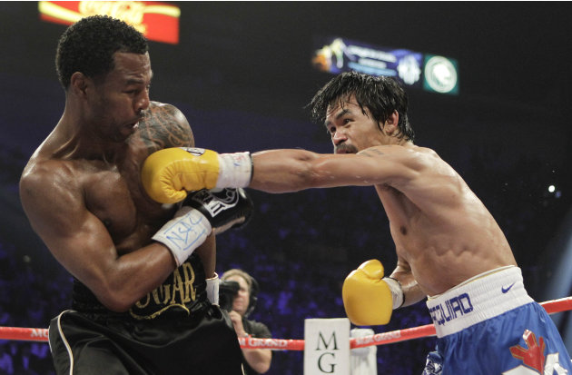 Manny Pacquiao, right, lands a punch against Shane Mosley in the fourth round during a WBO welterweight title bout, Saturday, May 7, 2011, in Las Vegas.  (AP Photo/Isaac Brekken)