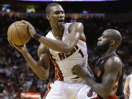 Wade, James carry Heat past Raptors in OT, 123-116