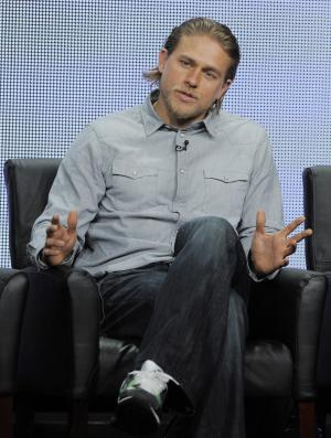 """FILE - In this Friday, Aug. 2, 2013 file photo, Charlie Hunnam, a cast member in the FX series """"Sons of Anarchy,"""" answers a reporter's question during the FX 2013 Summer TCA press tour in Beverly Hills, Calif. Just weeks after being cast as the lead of the high-anticipated big-screen version of """"Fifty Shades of Grey,"""" Hunnam is dropping out of the film. Universal announced Saturday, Oct. 12, 2013 that the actor who was to play Christian Grey will depart the project. The studio called it a mutual decision because Hunnam's preparation time was limited by his television schedule. (Photo by Chris Pizzello/Invision/AP)"""