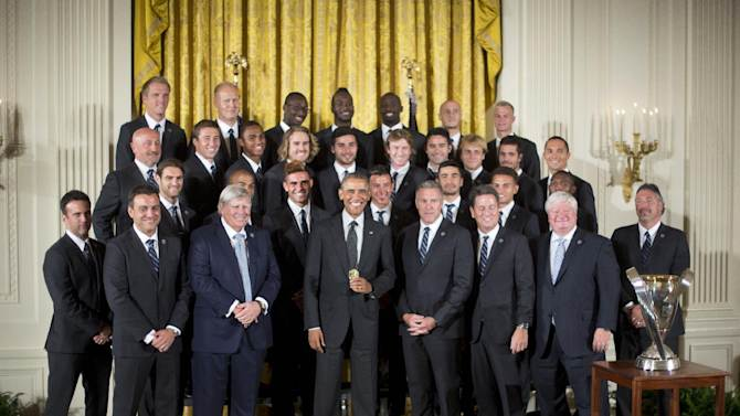 President Barack Obama poses with members of the Sporting Kansas City soccer team during a ceremony in the East Room of the White House in Washington, Wednesday, Oct. 1, 2014, where he honored the 2013 Major League Soccer champions. (AP Photo/Pablo Martinez Monsivais)