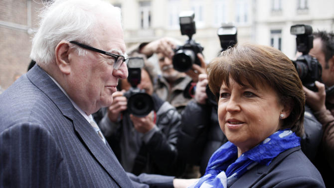 FILE - This Sunday, May 6, 2012 file photo shows French Socialist Secretary General Martine Aubry, right, and former socialist Prime Minister, Pierre Mauroy after voting in the second round of the French presidential election in Lille, northern France. Pierre Mauroy, who as France's prime minister implemented a wide range of radical social reforms under Socialist president Francois Mitterrand, has died at 84. Foreign Minister Laurent Fabius said Mauroy died Friday June 7, 2013 min a hospital in a suburb of Paris. He had been suffering from cancer. (AP Photo/Michel Spingler, File)